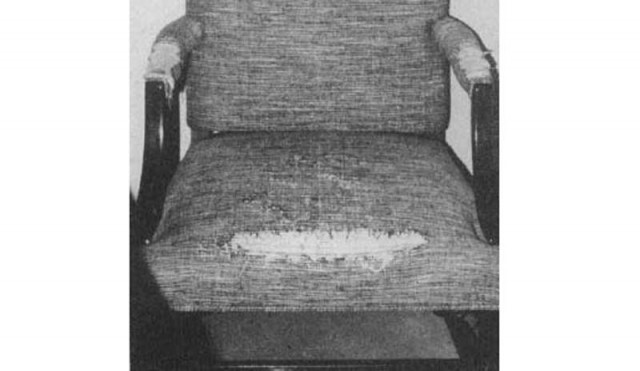 A chair with its front worn out.